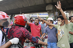 Bangladeshi transportation workers block a road as they gather in a protest demanding relief and reopen the public transport during the nationwide lockdown, in Dhaka, Bangladesh, May 7, 2020. Bangladesh imposed a nationwide lockdown to curb the spread of the novel coronavirus. Authorities banned passenger travel via water, rail and on domestic air routes from March 24. Photo by Suvra Kanti Das/ABACAPRESS.COM