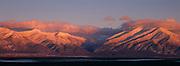 Sunset creates alpen glow on Taos Mountain.