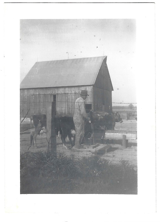 """""""my father at pump in barn yard (save picture for barn)"""""""