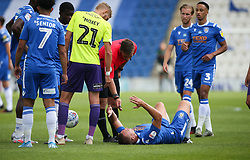 Luke Norris of Colchester United takes a blow on the face - Mandatory by-line: Arron Gent/JMP - 18/06/2020 - FOOTBALL - JobServe Community Stadium - Colchester, England - Colchester United v Exeter City - Sky Bet League Two Play-off 1st Leg