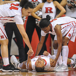 Rutgers Scarlet Knights guard Khadijah Rushdan (1) screams in pain after falling on her back trying to grab a rebound during first half NCAA Women's Basketball action between the Rutgers Scarlet Knights and Seton Hall Pirates at the Louis Brown Athletic Center. Rutgers leads Seton Hall 28-19 at halftime.