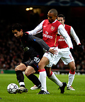 Photo: Ed Godden.<br /> Arsenal v CSKA Moscow. UEFA Champions League, Group G. 01/11/2006. CSKA Moscow's Dudu (R) is tackled by Gilberto.