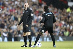 World XI's Eric Cantona warms up prior to the UNICEF Soccer Aid match at Old Trafford, Manchester.