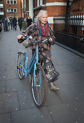 © Licensed to London News Pictures. 04/02/2016. London, UK. Dame Vivienne Westwood wheels her bicycle away from  the Ecuadorian embassy in London where WikiLeaks founder Julian Assange is currently living.  A United Nations panel is due to decide if Julian Assange has been kept in 'unlawful detention' during his stay at the embassy for the past three-and-a-half-years. Photo credit: Peter Macdiarmid/LNP
