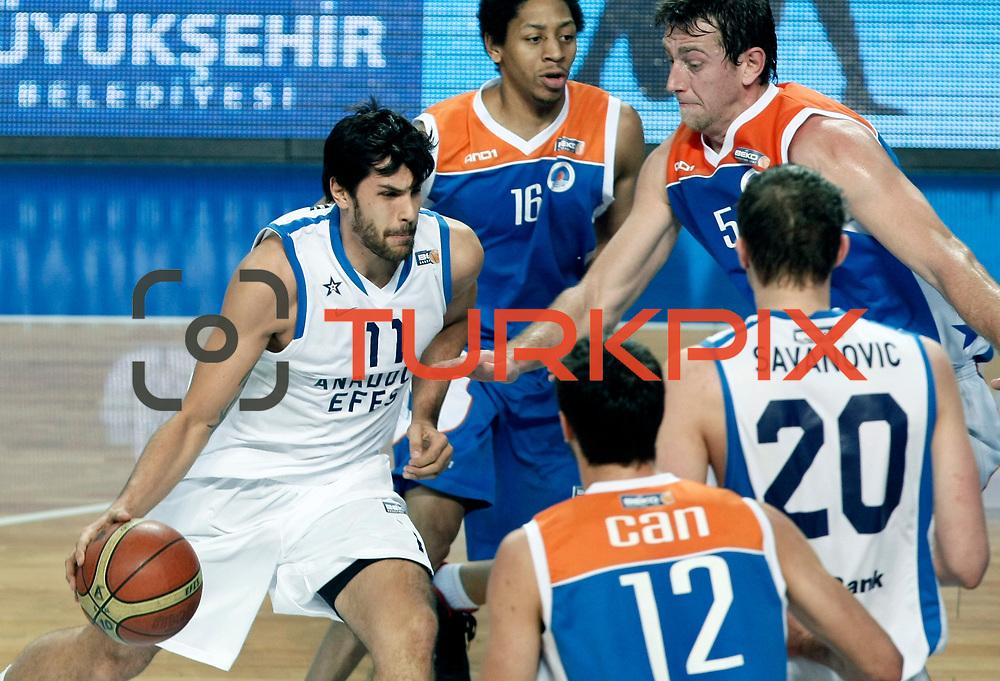 Anadolu Efes's Cenk Akyol (L) during their Turkish Basketball League match Anadolu Efes between Mersin BSB at Sinan Erdem Arena in Istanbul, Turkey, Saturday, January 14, 2012. Photo by TURKPIX