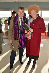 The 8th EARL OF CARNARVON and COUNTESS OF CARNARVON at the 2013 Hennessy Gold Cup at Newbury Racecourse, Berkshire on 30th November 2013.
