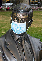 Mr Bean Statue wearing a surgical mask  leicester Sq London photo by Brian Jordan