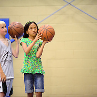 060214  Adron Gardner/Independent<br /> <br /> Isaac Zwiers, left, watches as Kaia Tempest sights a field goal during the Rehoboth basketball camp in Rehoboth Monday.