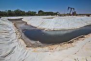 Frack pond in Big Spring Texas used by the fracking industry in the Permian Basin. In Big Spring citizens are limited in their water use do to drought conditions, though the fracking industry has no limit restrictions for their water usage.