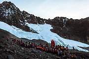 Men go up to the sacred mountain Sinaqara to worship to all the mountains or Apus, during the celebration of the Lord of Qoyllur Rit'i (The Lord of the Shining Snow) in Cusco, Peru. By the climate change the glacier is retiring, now in the place of the ritual there isn't snow, for them, snow is sacred and an important part of the celebration.