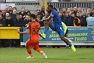 AFC Wimbledon defender Deji Oshilaja (4) with a shot on goal during the EFL Sky Bet League 1 match between AFC Wimbledon and Southend United at the Cherry Red Records Stadium, Kingston, England on 24 November 2018.