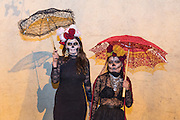 Two women dressed as La Calavera Catrina pose during the Day of the Dead festival November 1, 2016 in San Miguel de Allende, Guanajuato, Mexico. The week-long celebration is a time when Mexicans welcome the dead back to earth for a visit and celebrate life.