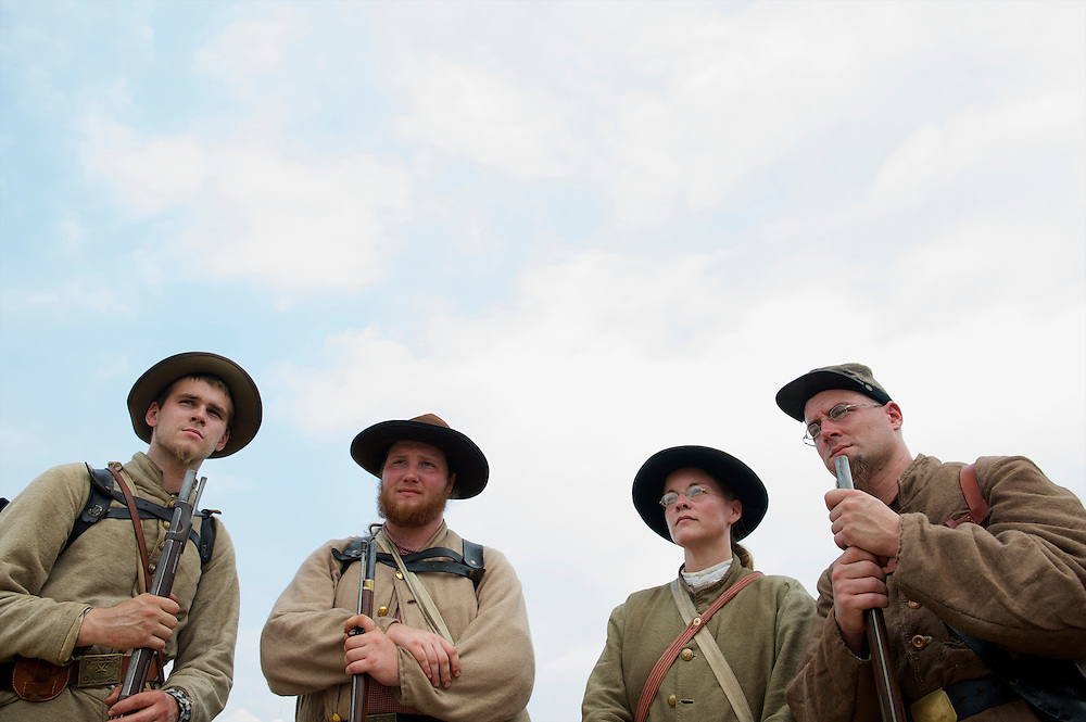 Rebel soldiers (L-R) Todd Smith, 20, Ryan Sype, 19, Serena Belue, and Cory Welchance, 31, seeking absolute fidelity in their historical interpreting, pose for a portrait during the 149th Gettysburg Reenactment in Gettysburg, Pennsylvania.