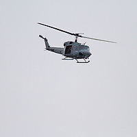 The UH-1N Huey helicopters is a twin-piloted, twin-engine helicopter used in command and control, resupply, casualty evacuation, liaison and troop transport. The Huey provides utility combat helicopter support to the landing force commander during ship-to-shore movement and in subsequent operations ashore.  This helicopter provided air cover and escort for the USS New York which was leaving New York Harbor after its commissioning.
