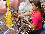 29 FEBRUARY 2008 -- BANGKOK, THAILAND:  A food vendor sells deep fried insects from her street cart on Soi Nana in Bangkok Thailand.    Photo by Jack Kurtz
