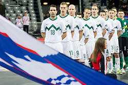 Damir Pertic of Slovenia, Alen Fetic of Slovenia, Rajko Ursic of Slovenia, Benjamin Melink of Slovenia and other players of Slovenia listening to the national anthemn during futsal match between Slovenia and Ukraine at Group stage of European Futsal Championship Croatia 2012, on February 2, 2012 in Arena Zagreb, Zagreb, Croatia.  (Photo By Vid Ponikvar / Sportida.com)