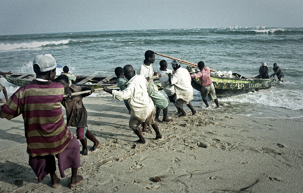 Pulling the boats in, fishermen, Kenya