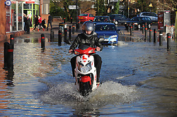 © Licensed to London News Pictures. 26/12/2013<br /> Motor Bike in flood water in Angel Lane, Tonbridge,Kent.<br /> Angel Lane in Tonbridge is badly flooded today (26.12.2013) with the local Sainsburys car Park totally under water.<br /> Boxing day flooding in Kent.<br /> Large parts of Kent are still flooded due to heavy rain with more bad weather expected.<br /> Photo credit :Grant Falvey/LNP
