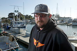 R.J. Waldron, the captain of a sports fishing tour boat, poses aboard the vessel at its berth in the marina in Emeryville, Calif., Thursday, June 2, 2016. (Photo by D. Ross Cameron)