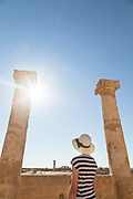 Female tourist exploring old ruins against sunny sky, Paphos Archaeological Park, Paphos, Cyprus