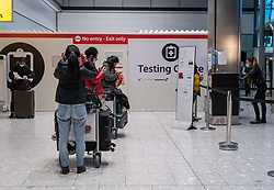 © Licensed to London News Pictures. 17/01/2021. London, UK. Passengers queue up at a testing centre at London Heathrow. Passengers arriving from abroad on Monday morning will have to show that they have had a negative Covid-19 test. Today, Foreign Secretary Dominic Rabb, said that lockdown could be lifted in March but with tier systems in place as health chiefs reveal that a 24/7 vaccination pilot will begin next week as total Covid-19 deaths reach over 88,000 this weekend. Photo credit: Alex Lentati/LNP