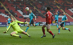 Charlton Athletic's Nicky Ajose beats Fleetwood Town goal keeper Alex Cairns but this effort is ruled out off side