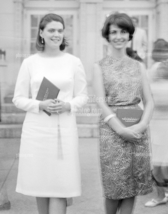 Kathryn Anderson and Joanne Auditore, best friends, in front of Hamden High School after Graduation Ceremony, June 1965.