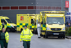 © Licensed to London News Pictures 05/01/2021.        Dartford, UK. A long line of ambulances outside Darent Valley Hospital in Dartford, Kent this afternoon. As the number of seriously ill Coronavirus patients continues to grow some patients are having to be transferred miles away from Kent to help with the critical care bed shortage. Photo credit:Grant Falvey/LNP