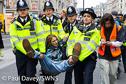 Police start making arrests after issuing protesters with a Section 14 notice at an impromptu rave at Oxford Circus as hundreds of environmental protesters from Extinction Rebellion occupy Oxford Circus, a pink yacht being the focal point of their presence, with traffic denied access to two of London's busiest streets. London, April 16 2019.