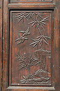Ornate wooden door carving with likenesses of birds and bamboo plants, Old Town, Tunxi district, Huangshan City, Anhui Province, China