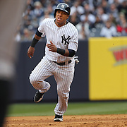 Yangervis Solarte, New York Yankees, runs to third during the New York Yankees V Baltimore Orioles home opening day at Yankee Stadium, The Bronx, New York. 7th April 2014. Photo Tim Clayton