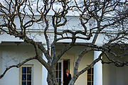 President Donald Trump emerges from the Oval Office with First Lady Melania Trump as they depart the White House en route to Mar-a-Lago, the Presidents private club, where they will spend Christmas and New Years Eve in Washington, DC on December 23, 2020. Republicans and Democrats came to an agreement over the weekend on the coronavirus relief bill but President Trump released a video message on Tuesday where he criticized the bill and hinted that he may veto the Bill if Congress did not increase the $600 stimulus payments to $2,000.