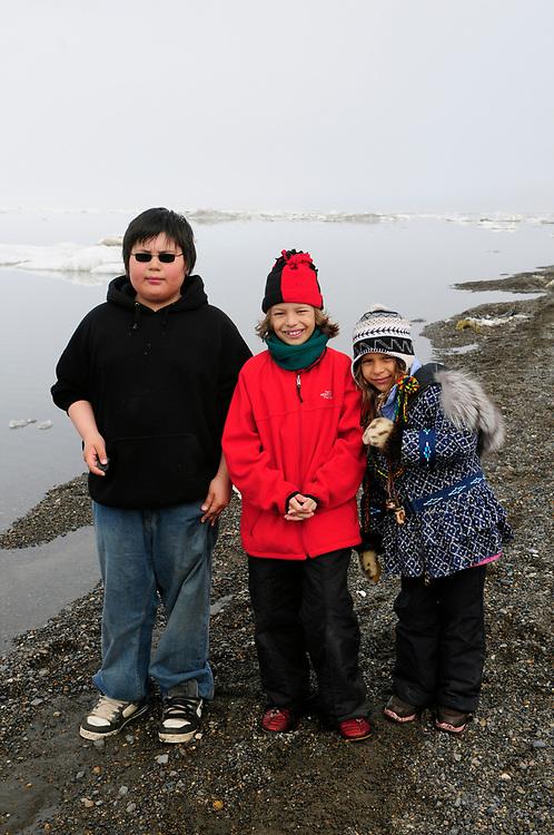 Barrow, Alaska, June 28th, 2008. Summer. Arctic Ocean. Kids playing at the beach in Barrow. Qusigvun Patkotak, James and Juliana Whitaker Aikins. MR