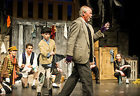 "Oliver (Tyler Browne) picks the pocket of Fagin (David Bownes) during dress rehearsal for the Streetcar Company's production of ""Olivier"" at the Inter Lakes High School auditorium Thursday evening.  (Karen Bobotas/for the Laconia Daily Sun)"