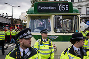 Environmental activists from Extinction Rebellion use a vintage bus to block a road junction to the south of London Bridge on the ninth day of their Impossible Rebellion protests on 31st August 2021 in London, United Kingdom. Extinction Rebellion are calling on the UK government to cease all new fossil fuel investment with immediate effect.