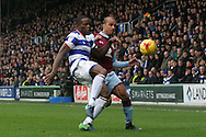 Gabriel Agbonlahor of Aston Villa (R) battling for the ball with Nedum Onuoha of Queens Park Rangers (L). EFL Skybet championship match, Queens Park Rangers v Aston Villa at Loftus Road Stadium in London on Sunday 18th December 2016.<br /> pic by Steffan Bowen, Andrew Orchard sports photography.