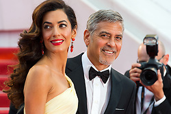 "File photo : George Clooney and his wife Amal Clooney arriving on the red carpet of 'Money Monster' screening held at the Palais Des Festivals in Cannes, France on May 12, 2016 as part of the 69th Cannes Film Festival. Amal Clooney and her husband George are expecting twins, US media report. The babies are due in June, according to CBS's The Talk host Julie Chen. Another source close to the couple, quoted by People, said they were ""very happy"". The Clooneys' representatives have not yet commented. Photo by Nicolas Genin/ABACAPRESS.COM"