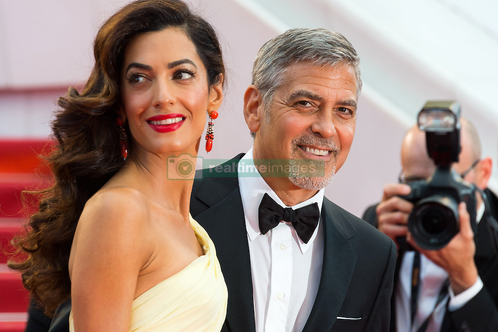 """File photo : George Clooney and his wife Amal Clooney arriving on the red carpet of 'Money Monster' screening held at the Palais Des Festivals in Cannes, France on May 12, 2016 as part of the 69th Cannes Film Festival. Amal Clooney and her husband George are expecting twins, US media report. The babies are due in June, according to CBS's The Talk host Julie Chen. Another source close to the couple, quoted by People, said they were """"very happy"""". The Clooneys' representatives have not yet commented. Photo by Nicolas Genin/ABACAPRESS.COM"""