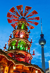 Traditional Christmas Market at Alexanderplatz in Mitte, Berlin, Germany. Pictured the Pyramiden Treff or Pyramid meeting place and Fersehturm, the television tower.