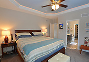 The master bedroom has a light blue ceiling, and recessed lighting around the perimeter of the cove. Through the bathroom at right is a walk-in closet area. Sheridan and Rikki Glen are At Home in their Tanglewood subdivision home in Caseyville, IL on Wednesday January 16, 2019. <br /> Photo by Tim Vizer