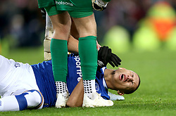 Everton's Richarlison goes down on the pitch after picking up an injury during the match