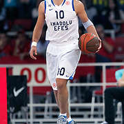 Anadolu Efes's Kerem TUNCERI during their Two Nations Cup basketball match Anadolu Efes between Olympiacos at Abdi Ipekci Arena in Istanbul Turkey on Sunday 02 October 2011. Photo by TURKPIX