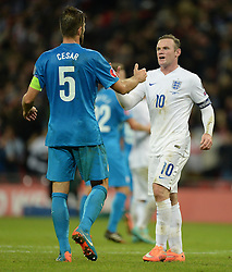 Bostjan Cesar of Slovenia embraces Wayne Rooney of England (Manchester United) - Photo mandatory by-line: Alex James/JMP - Mobile: 07966 386802 - 15/11/2014 - SPORT - Football - London - Wembley - England v Slovenia - EURO 2016 Qualifier