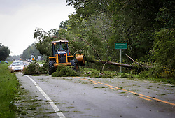 A front end loader helps clear trees off of Orange Blossom Trail in Intercession City, Fla. in Osceola County on Monday, Sept. 11, 2017 after Hurricane Irma plowed through Central Florida. Photo by Orlando Sentinel/TNS/ABACAPRESS.COM