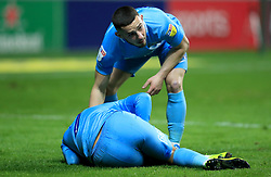 Coventry City's Conor Chaplin checks on team mate Jodi Jones (bottom) as he suffers an injury during the match