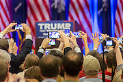Hundreds of supporters hold up camera phones to capture billionaire and GOP presidential candidate Donald Trump during victory celebrations for his win in the South Carolina Republican primary February 20, 2016 in Spartanburg, South Carolina, USA .