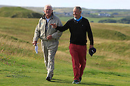 Arthur Pierse (Tipperary) walks up the 18th fairway with old friend Charlie Mulqueen after beating John-Ross Galbraith (Whitehead) 2&1 during Matchplay Round 2 of the South of Ireland Amateur Open Championship at LaHinch Golf Club on Friday 22nd July 2016.<br /> Picture:  Golffile | Thos Caffrey<br /> <br /> All photos usage must carry mandatory copyright credit   (© Golffile | Thos Caffrey)
