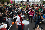 Climate change drummers dance in Trafalgar Square on 7th October, 2019 in London, Untited Kingdom. Extinction Rebellion plan to occupy 12 sites situated around key Government locations around Westminster for two weeks to protest against climate change.