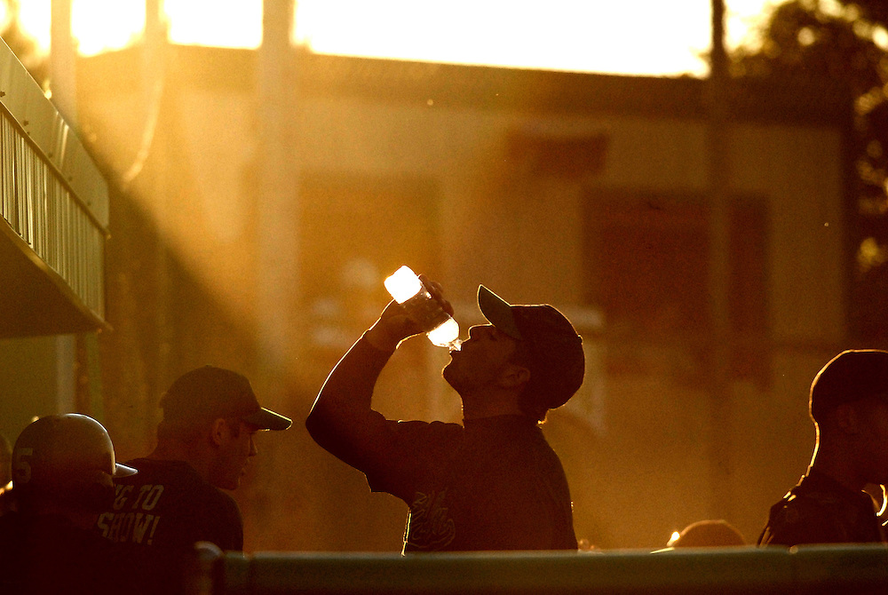(Staff Photo by Matt Roth)..Atholton High School's Dave Lanier quenches his thirst in between innings during a State Semi-final game held at Arundel High School Tuesday May 23, 2006 against Eastern Tech. Atholton lost the game 6-3.