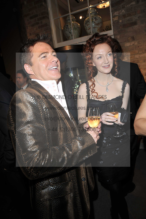CHARLES WORTHINGTON and OLIVIA GRANT at the BAFTA Nominees party 2011 held at Asprey, 167 New Bond Street, London on 12th February 2011.